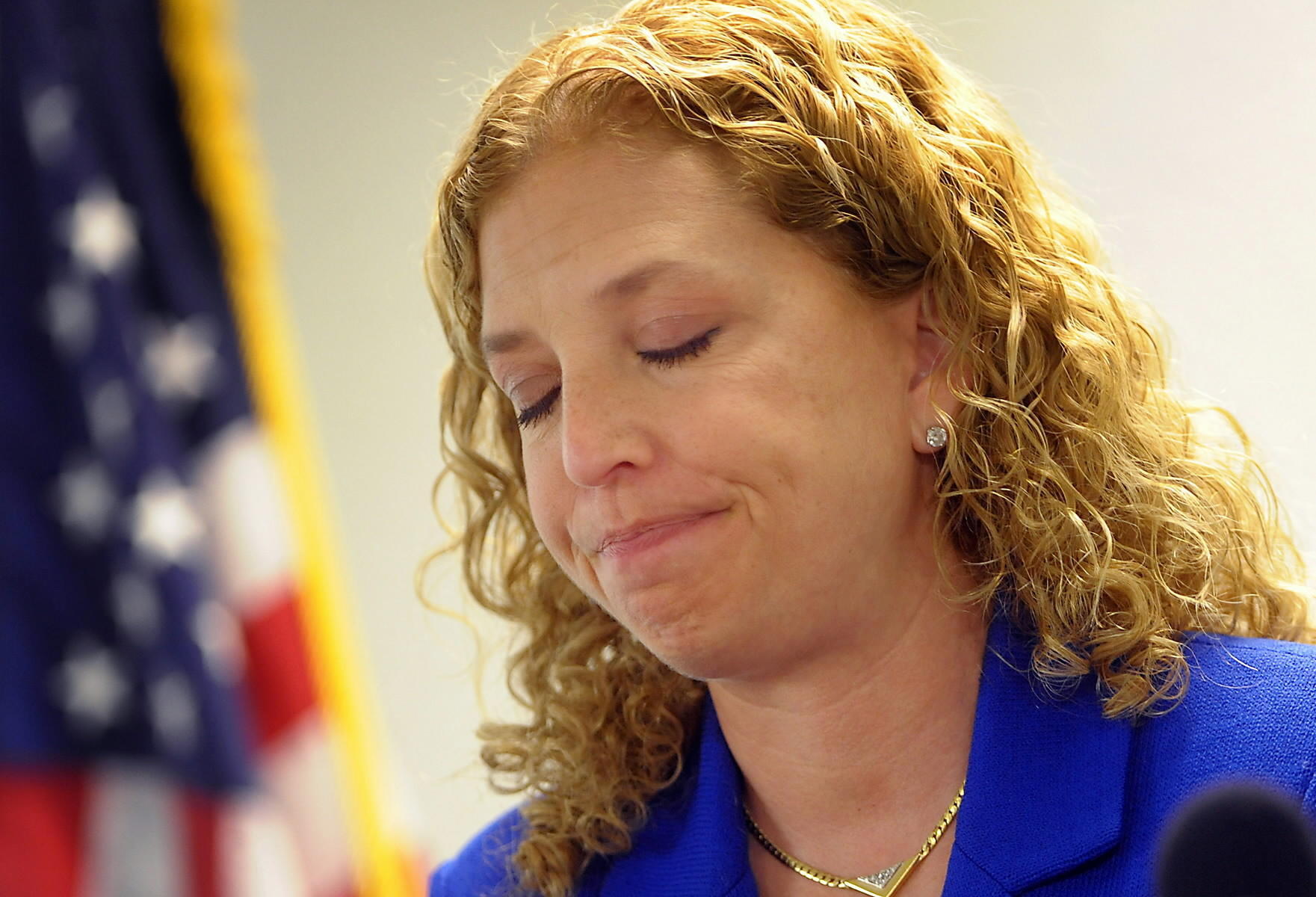 U.S. Rep. Debbie Wasserman Schultz, D-Weston, shows obvious dismay at a press conference held Sunday evening at Ft. Lauderdale-Hollywood International Airport to discuss the shooting of her friend and colleague, Rep. Gabrielle Giffords, in Tucson, Arizona.