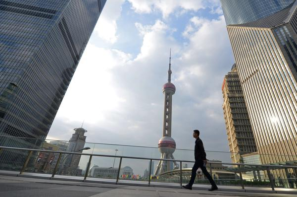 The Chinese state press has been notably restrained about a possible U.S. default. Above, Shanghai's financial district.