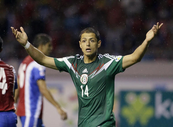 Mexico's Javier Hernandez, right, reacts after the referee disallowed a goal during a 2014 World Cup qualifying soccer match in San Jose, Costa Rica.