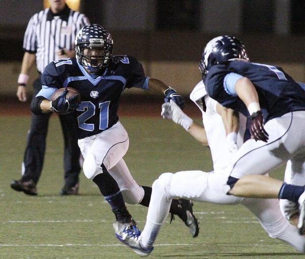 ARCHIVE PHOTO: Crescenta Valley High running back Jonathan Jun will look to help spark the Falcons to a Pacific League win against Glendale Friday.