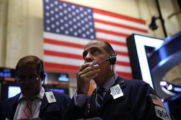 There really isn't much difference anymore between NYSE and Nasdaq. Pictured is a floor trader.