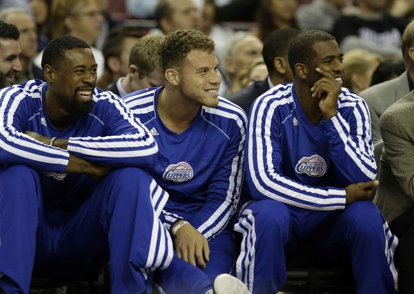 DeAndre Jordan, left, Blake Griffin and Chris Paul watch from the bench as the Clippers play the Sacramento Kings in an exhibition game Monday.