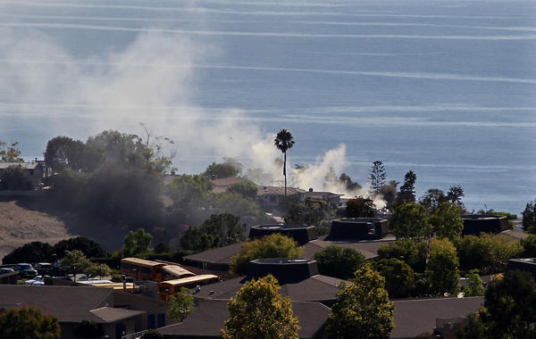 Smoke can be seen from Top of the World from a fire at a home storage shed on Bayview Place in Laguna Beach on Tuesday afternoon.