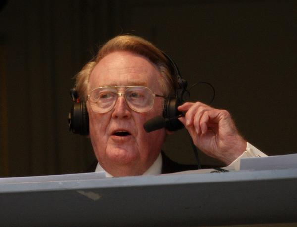 Vin Scully, shown broadcasting for the Dodgers in 2011, knows when to keep quiet.