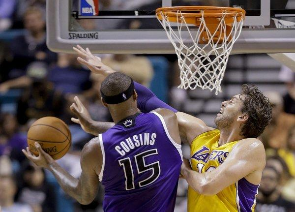 Pau Gasol goes up against DeMarcus Cousins during the Lakers' loss to the Sacramento Kings, 104-86, in Las Vegas.