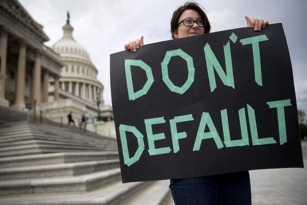 A woman holds a sign outside the U.S. Capitol in Washington.