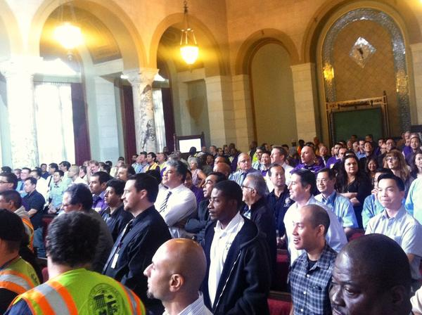 Los Angeles transportation department employees, including engineers and maintenance staff, packed City Hall to protest management policies.