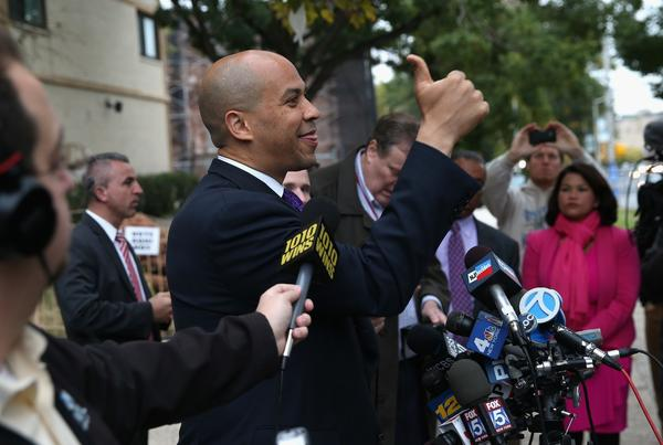 Newark Mayor Cory Booker greets a supporter after casting his vote in a special U.S. Senate election Wednesday. Booker, a Democrat, was leading in pre-election surveys over Republican Steve Lonegan.