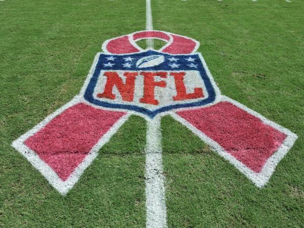 Football field in Tampa, Fla., for a game between the Tampa Bay Buccaneers and the Philadelphia Eagles, displays pink ribbon in support of October's breast cancer awareness month effort. How much good do these campaigns do?