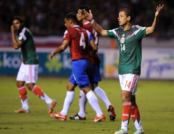 Mexico's Javier Hernandez (R) gestures during their Brazil 2014 FIFA World Cup Concacaf qualifier match against Costa Rica at the Nacional stadium in San Jose, on October 15, 2013.