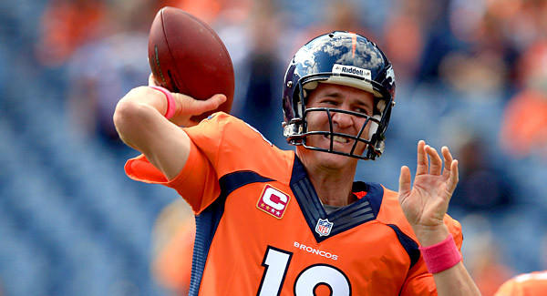 Quarterback Peyton Manning of the Denver Broncos warms up prior to facing the Jacksonville Jaguars.