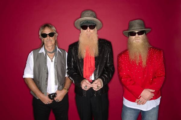 If the guy on the far left, Frank Beard (pictured with ZZ Top bandmates Billy Gibbons, center, and Dusty Hill in an OC Fair promotional shot), happens to call you on Friday, don't answer -- it's National No Beard Day.