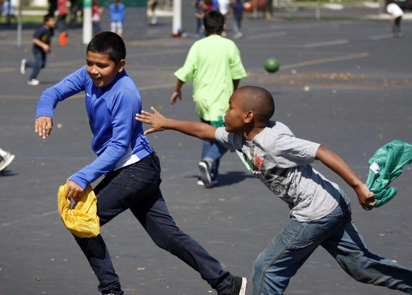 Cesar Chavez Elementary students play capture the flag at recess.