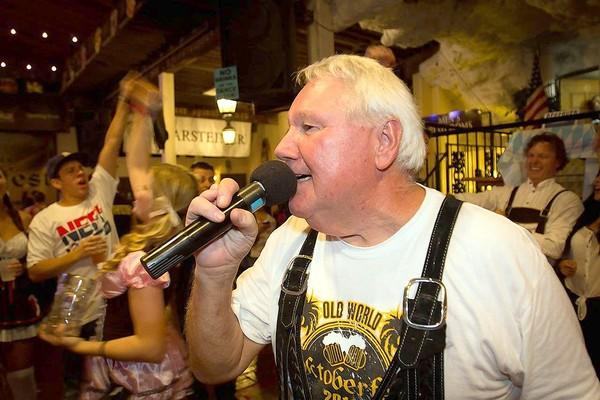 "Herb ""The Herbmeister"" Schwarz pumps up the crowd at Friday's Oktoberfest celebration. He has been the master of ceremonies for the last 30 years."