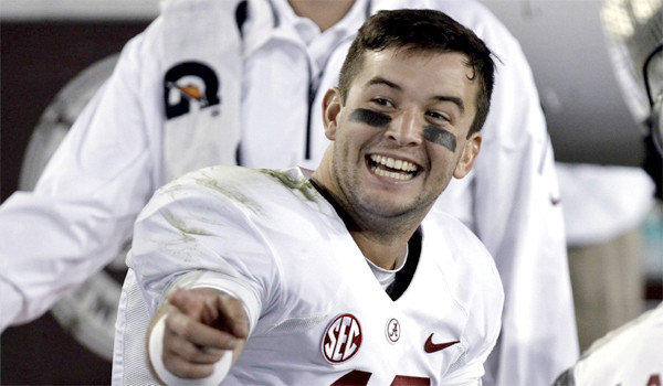 Quarterback A.J. McCarron is all smiles on the Alabama bench during a 48-7 Crimson Tide victory over Kentucky in which he passed for 359 yards and a touchdown with no interception.