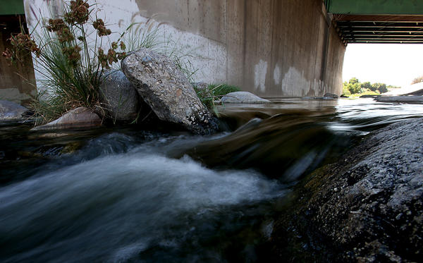 The Los Angeles River flows under the 134 Freeway in an area called the Glendale Narrows near Griffith Park.