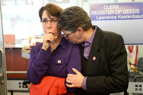 Dana Bauer, right, comforts partner Tracy Pennington after the couple learned they would not be able to apply for a marriage license Wednesday in Ann Arbor, Mich.
