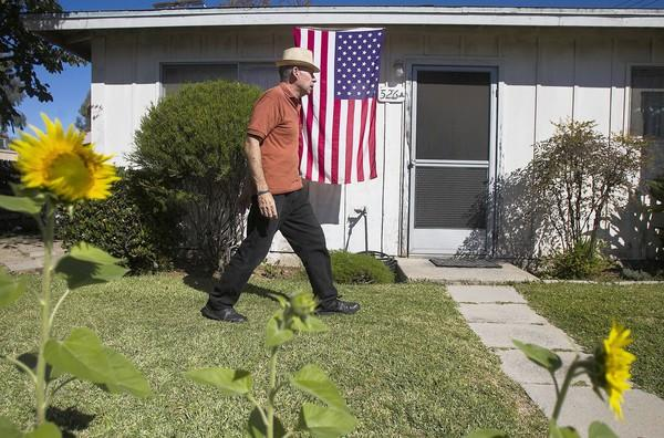 Tom Dobrzeniecki, 60, has lived in his two-bedroom, 660-square-foot bungalow on Bernard Street in Costa Mesa for 30 years. Seven bungalows built in the 1940s on a nearly half-acre plot are set to be replaced by new condos, part of new development coming to the Westside.