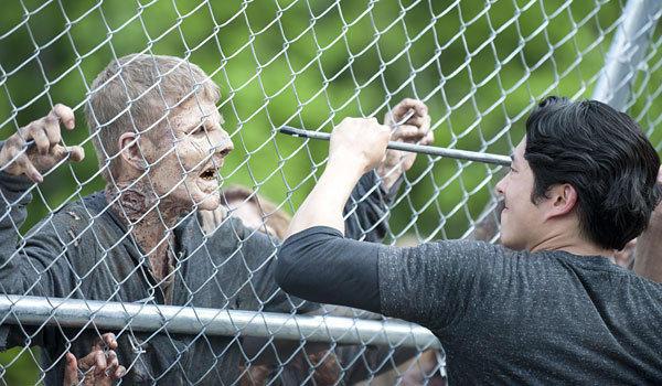 """Glen (Steven Yeun, right) battles a zombie in """"The Walking Dead."""""""