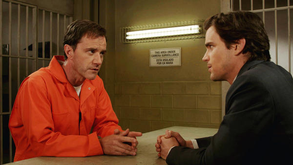 "Neal (Matt Bomer, right) has to figure out how to get Peter (Tim DeKay) out of jail in ""White Collar."""