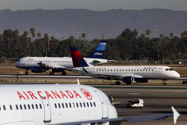 Airliners navigate Los Angeles International Airport.
