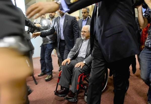 Iranian Foreign Minister Mohammad Javad Zarif leaves a news conference after two days of talks in Geneva. The Iranian blames pressure from hard-liners in his country for his intense back pain that has left him nearly immobilized.