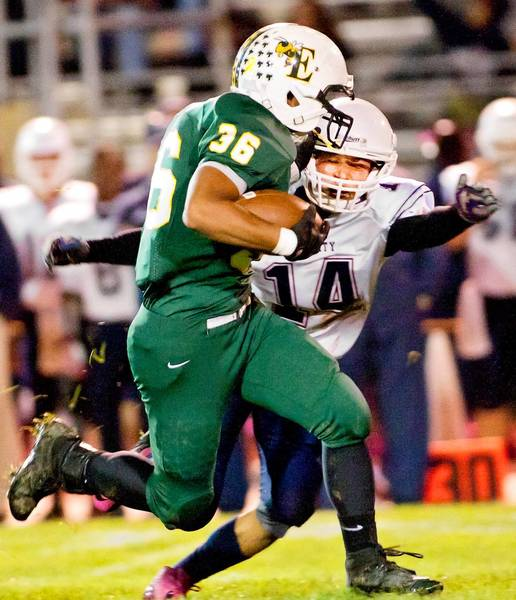 Emmaus' Daniel Velasco (36) heads upfield against Liberty defender Raymond Pacheco (14) in the first quarter of their game at Emmaus High School on Friday night.