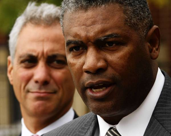 Chicago Housing Authority CEO Charles Woodyard, right, who announced his resignation this week, supported efforts to help ex-offenders transition to CHA housing.