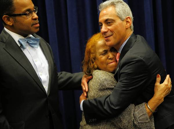 Constance Martin, widow of former Chicago police Superintendent Leroy Martin, gets a hug from Mayor Rahm Emanuel on Wednesday as the City Council honored Martin, who died recently. Son Leroy Martin Jr. looks on.