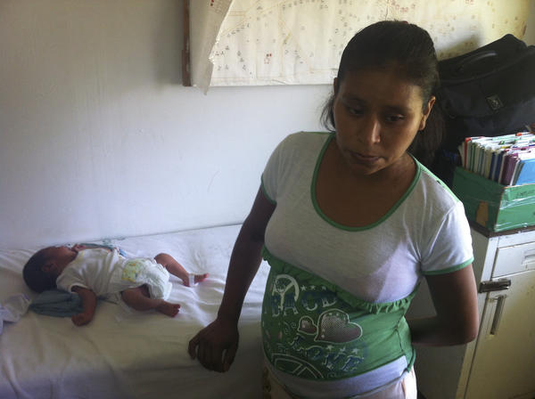Irma Lopez, 29, with her newborn son, Salvador, at a clinic in Jalapa de Diaz, Mexico. Mexican officials suspended two hospital directors after Lopez, an indigenous woman, was denied entry and was forced to give birth on the lawn.