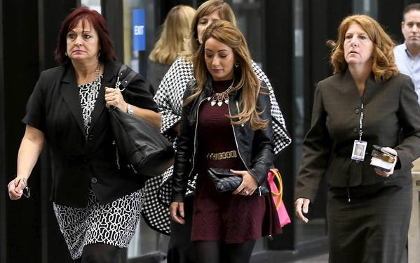 Carla McShane, 23, center, arrives with family and friends Wednesday at the trial of Heriberto Viramontes, who allegedly assaulted McShane's sister Natasha and her friend Stacy Jurich with a baseball bat in Bucktown on April 23, 2010.