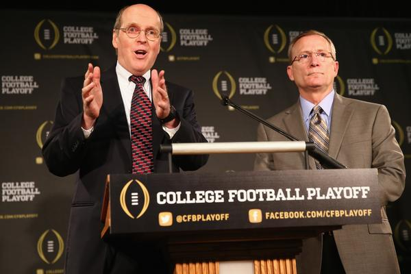 Bill Hancock, executive director of the College Football Playoff, introduces Jeff Long as the chairman of the College Football Playoff selection committee.