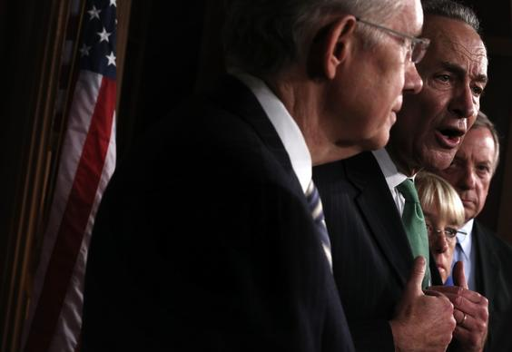 Democratic Sens. Harry Reid, Charles Schumer, Patty Murray and Richard Durbin attend a news conference after voting on a budget deal.