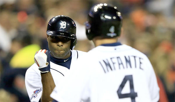 Omar Infante, right, celebrates with Torii Hunter, left, after Infante scored on a single by Austin Jackson in the fourth inning of Detroit's 7-3 win over the Boston Red Sox in Game 4 of the American League Championship Series on Wednesday.