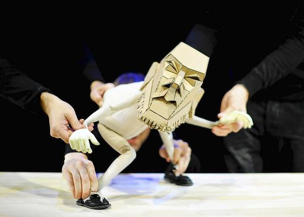 """Blind Summit Theatre puppeteers bring a cantankerous puppet to life in """"The Table,"""" a Chicago Shakespeare Theater World Presentation."""