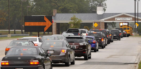 Traffic approaches the Fort George G. Meade main gate Thursday morning.