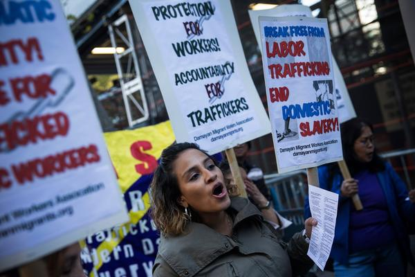 Jessica Penaranda of New York and others protest against labor trafficking and modern-day slavery outside the United Nations in New York on Sept. 23.