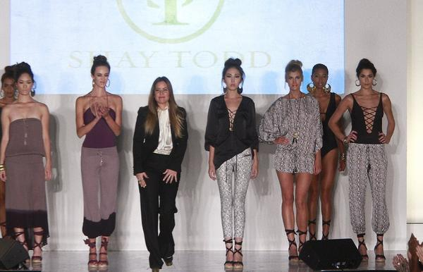 "Designer Shay Todd and models take a bow at Fashion Business Inc.'s ""All Aboard"" fundraiser."