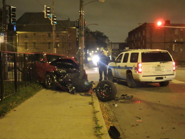 A 15-year-old boy and three adults were injured when their SUV crashed into a pole after fleeing a traffic stop at about midnight at the intersection of 71st Street and Wentworth Ave. in the Englewood neighborhood.