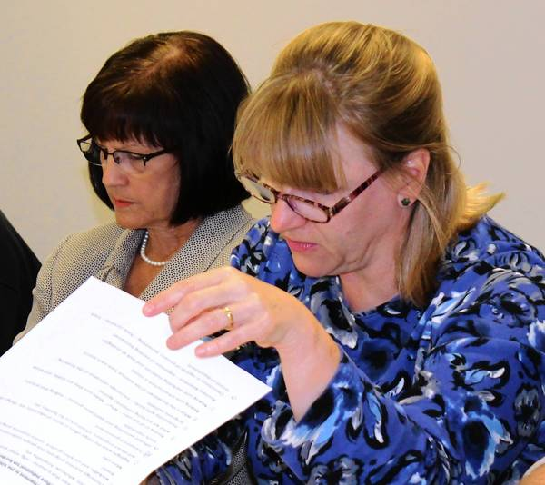 Economic Commercial Commission members Rebecca Palumbo, foreground, and Kathy Mahoney consider which of Tinley Park's attributes are the most important. The attributes were generated during previous brainstorming sessions.