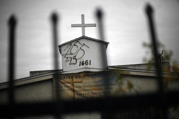 Graffiti marred the steeple on the Greater Holy Faith Baptist Church on 155th Street in Compton in January. Two members of 155th Street Gang were charged with federal hate crimes.