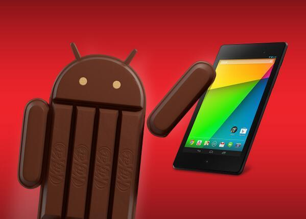 An image of a KitKat version of the Android mascot with the Nexus 7 tablet.