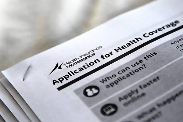 Applications are seen at a rally held by supporters of the Affordable Care Act in Jackson, Mississippi.