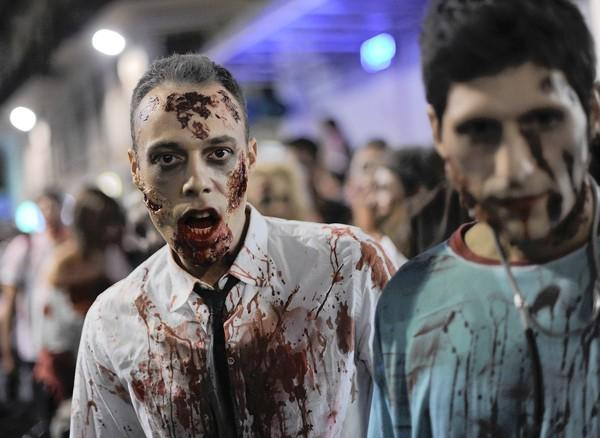 People dressed as zombies take part in a Zombie Walk in Sitges, near Barcelona, on October 12, 2013.
