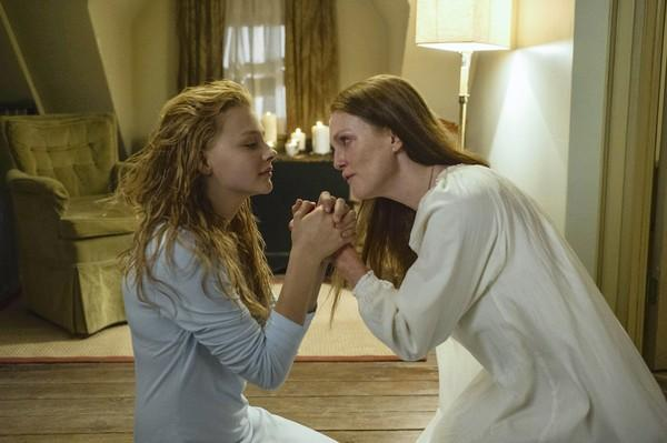 "Chloë Grace Moretz, left, and Julianne Moore in the remake of ""Carrie."""