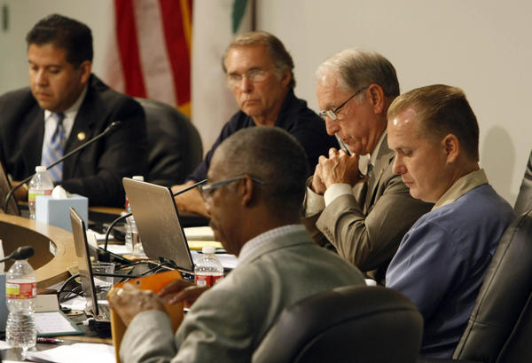 San Bernardino Councilman Chas Kelley, far right