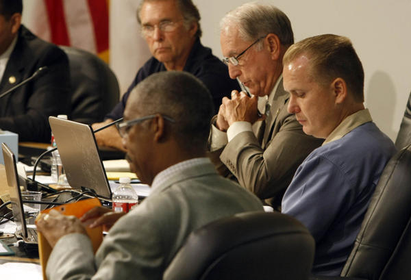 San Bernardino Councilman Chas Kelley, far right, resigned Thursday and quit running for mayor after pleading guilty to perjury.