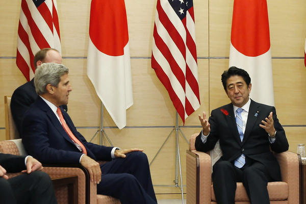 Japanese Prime Minister Shinzo Abe, center, speaks as U.S. Defense Secretary Chuck Hagel, left, U.S. Secretary of State John Kerry, second from left, Japanese Foreign Minister Fumio Kishida, second from right, and Japanese Defense Minister Itsunori Onodera listen during their meeting at the prime minister's official residence in Tokyo.