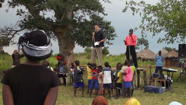 "Jesse Digges preaches to Ugandans in a scene from Roger Ross Williams' ""God Loves Uganda."""