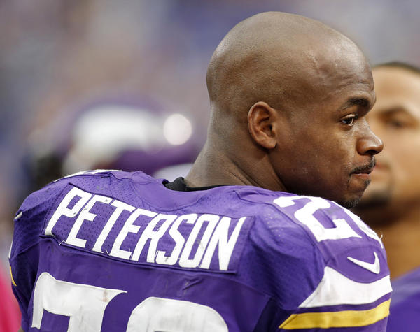 Vikings running back Adrian Peterson walks along the sideline late in the game against the Panthers.